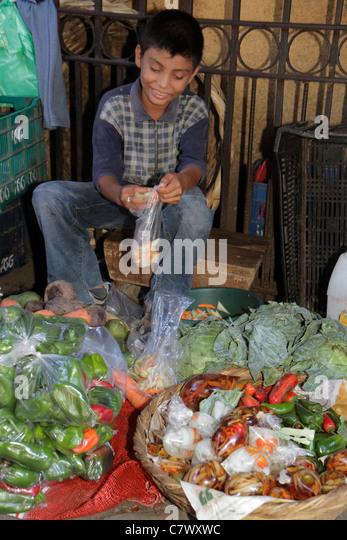 Nicaragua Granada Calle Atravesada shopping market produce vendor agriculture vegetables informal economy plastic - Stock Image