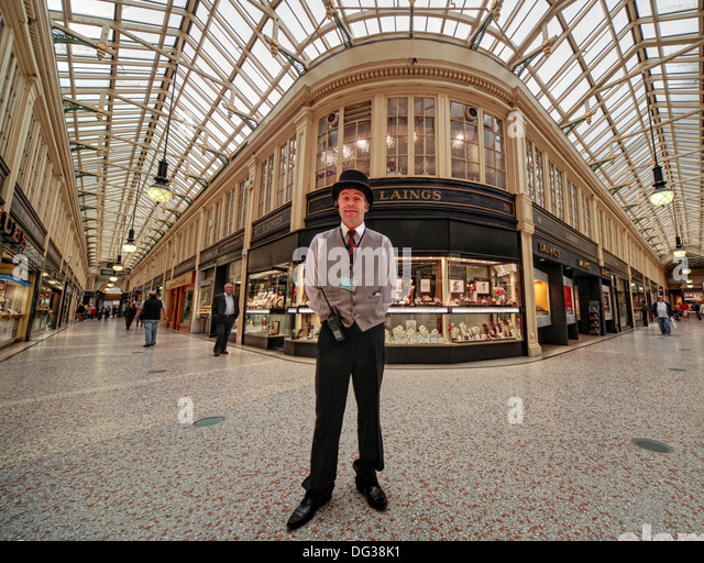 Concierge security man at Argyll Arcade Victorian Glasgow shopping mall , Scotland, UK - Stock Image