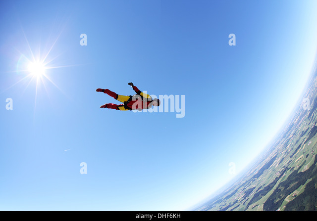 Skydiver free falling face down above Leutkirch, Bavaria, Germany - Stock-Bilder