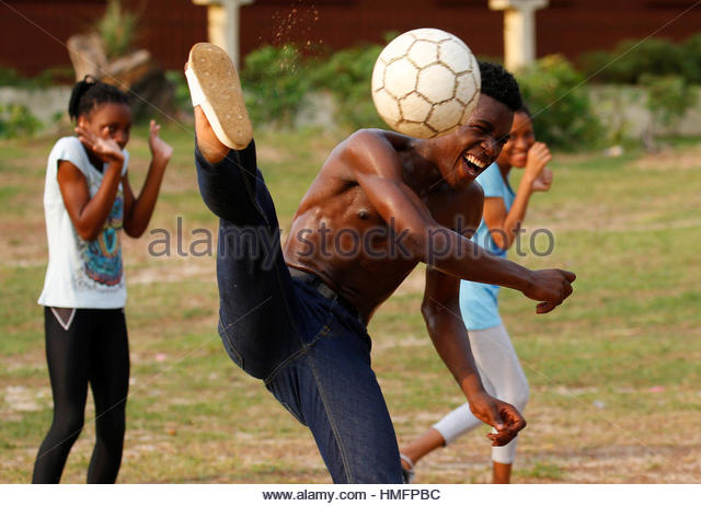 Youths practice their soccer skills at a park ahead of the African Nations Cup soccer final in Libreville, Gabon, - Stock-Bilder