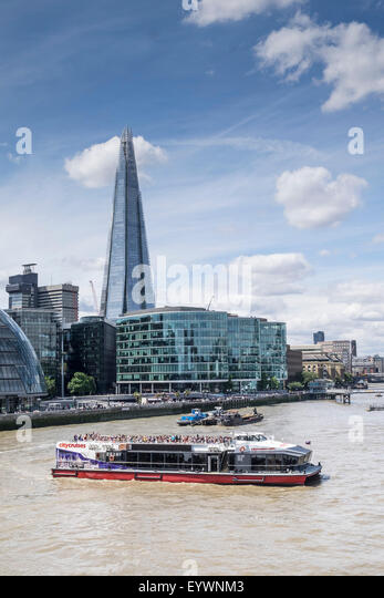 A pleasure cruiser turning on the River Thames in London. - Stock Image