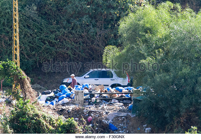 Beirut Lebanon 27th September 2015. A man walks past bags of rubbish as the Lebanon waste crisis which has sparked - Stock Image