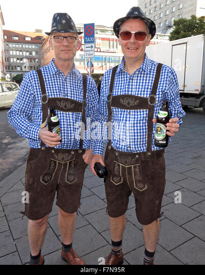 Oktoberfest in Munich,Baveria,Germany. Two Tourists in Lederhosen, - Stock Image