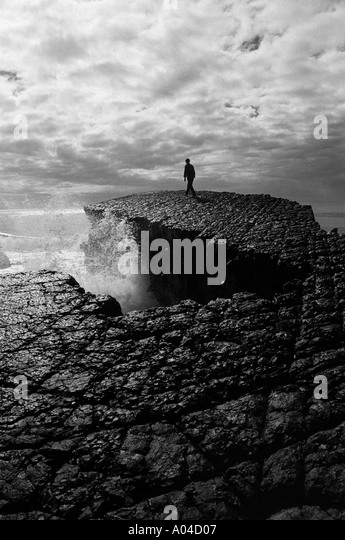 Black and white of a person alone in natural coastal environment - Stock-Bilder