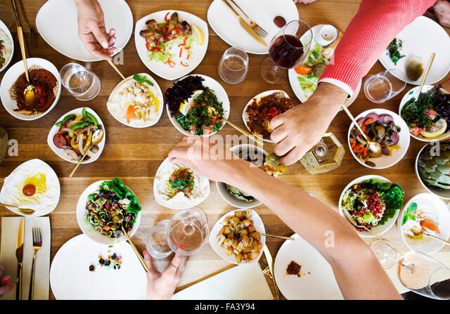 High angle view of friends having meze at table in Lebanese restaurant - Stock-Bilder