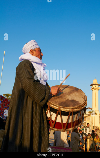 Drummer at Tahtib demonstration, Mosque of Abu el-Haggag, Luxor, Egypt - Stock Image