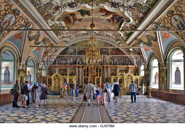 The Main altar with icons and painted walls in the Cathedral of the Holy Trinity St. Sergius Lavra in Sergiyev Posad - Stock Image