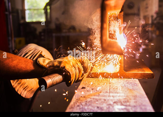 Close-up of welder working - Stock Image