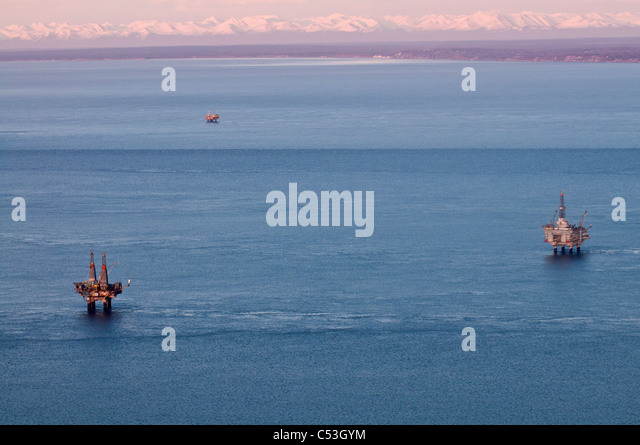 Aerial evening view of oil platform in Cook Inlet, Southcentral Alaska, Winter - Stock Image