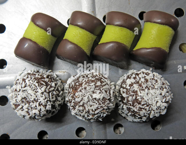 Swedish SÖTSAK DAMMSUGARE A pastry with marzipan coating and chocolate dipped ends - Stock Image