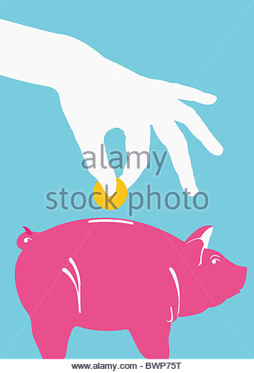Person putting coin into piggy bank - Stock Image