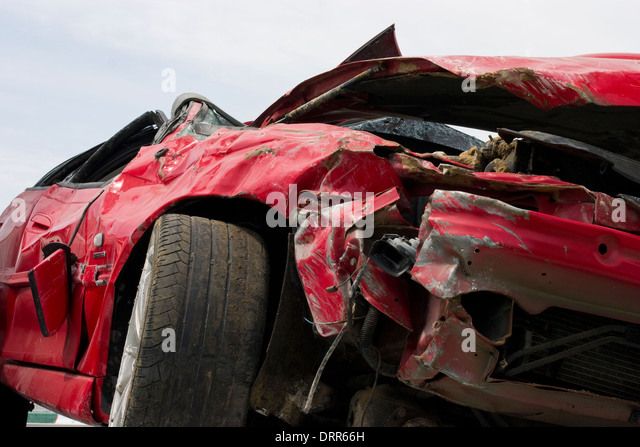 The wreckage of a crashed car displayed by Qatar's police during Traffic Week, 2005, - Stock Image