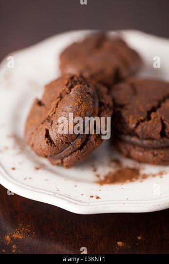 Chocolate Cream Cookies on White Vintage Plate - Stock Image