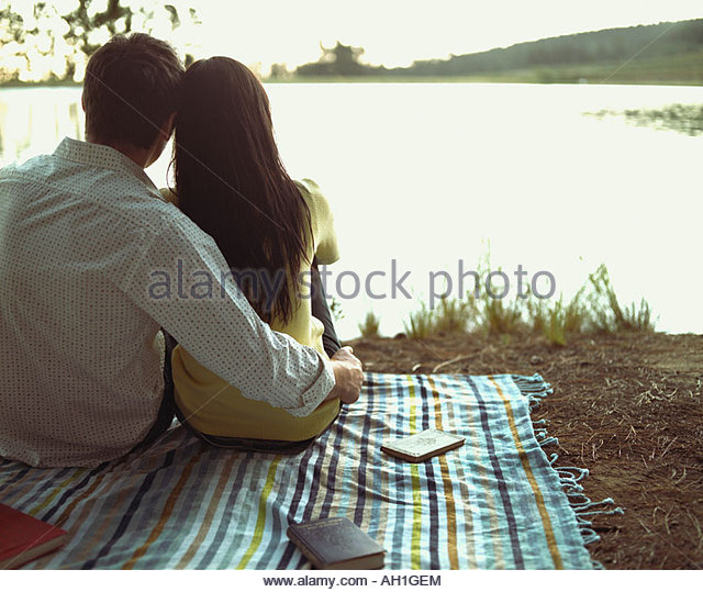 A couple relaxing by a lake - Stock-Bilder