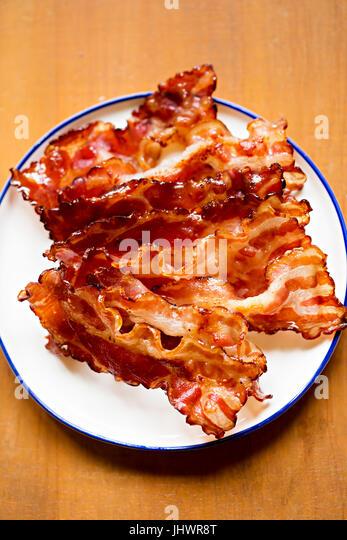 Streaky fried bacon rashers - Stock Image