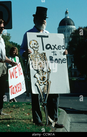 Demonstrators outside the state Capitol in Sacramento, CA during the first annual Taxpayer's Action day. - Stock Image