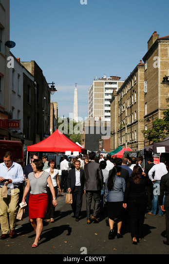 Whitecross Street Food Market, St Luke's, City of London, UK. The steeple of St Luke's church can be seen - Stock Image