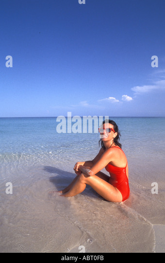 BEACH Woman in Red Bathing Suit - Stock Image