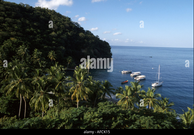 West Indies St. Lucia Anse Chastanet Resort restaurant view Caribbean Sea palm trees boats - Stock Image