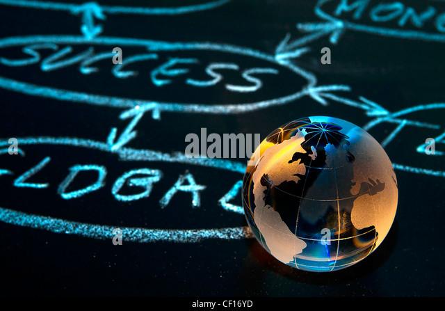Flowchart on a chalk board with world globe showing America - Stock-Bilder