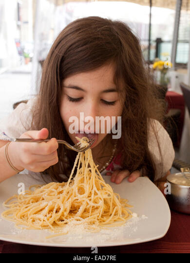 girl eating Spaghetti - Stock Image