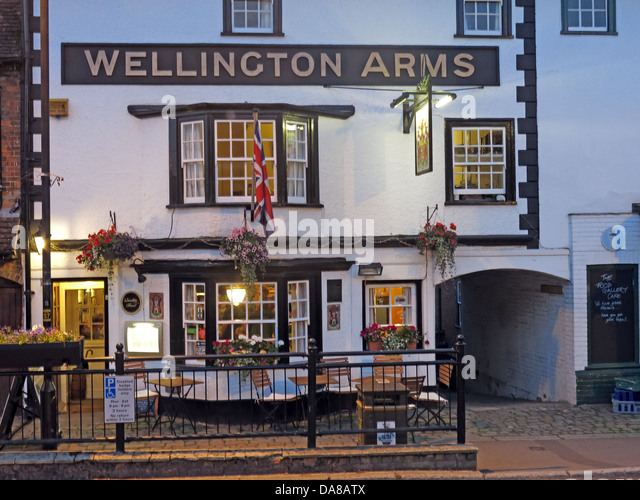 The Wellington Arms, 46 High St, Marlborough SN8 1HQ  at dusk - Stock Image