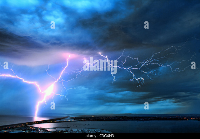UK, Dorset, Stunning image of lightning over the Dorset coast during weekend storms after hot dry weather. - Stock Image