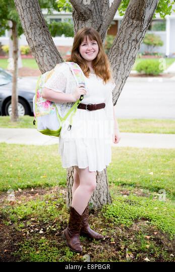Portrait of teenage girl (13-15) with backpack - Stock-Bilder