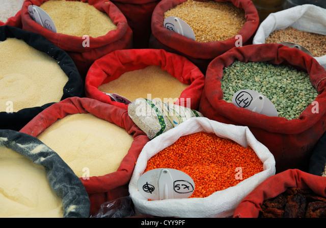 Oriental pulses (peas, lentils) and grains (rice, bulgur, semolina, couscous, wheat) for sale on food market - Stock Image