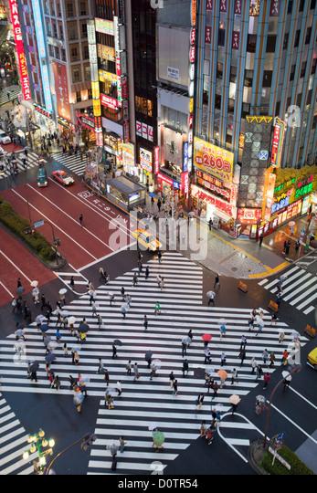 Japan, Asia, holiday, travel, Tokyo, City, Shinjuku, District, Shinjuku, Avenue, crossing, downtown, rain, rainy, - Stock Image
