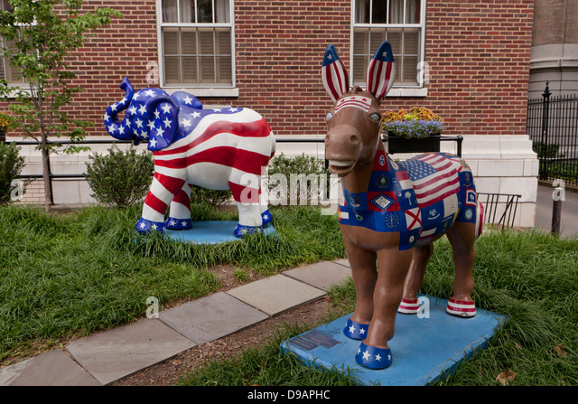 US political party mascots, donkey and elephant, painted in red, white, and blue - Stock Image