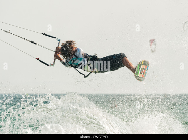 A kitesurfer in mid action. - Stock Image