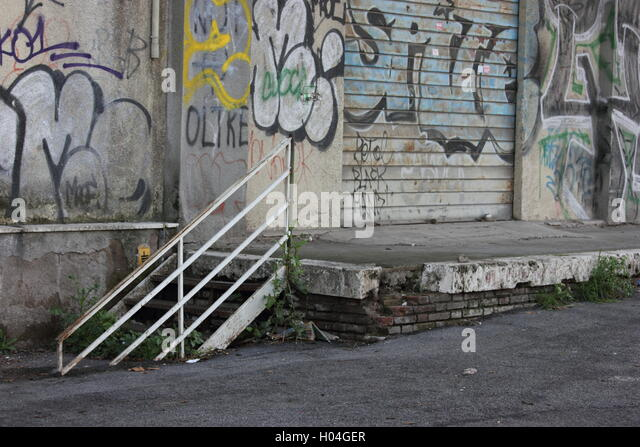 a beautifully decayed urban street alleyway with graffiti, photoarkive - Stock Image