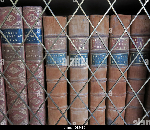 Old antique books in a library,locked away - Stock Image