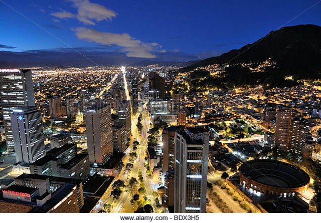 Panoramic night view of Bogota, the capital of Colombia, of the Avenida Carrera Septima with the bullring Santa - Stock Image