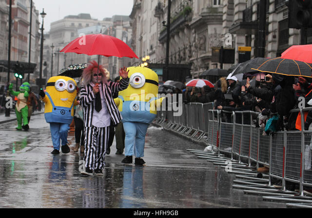 London, UK. 1st January 2017. A performers dressed a movie icons participates in the  New Year's Day Parade - Stock Image