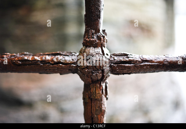 Corroded rusty iron cross - Stock Image
