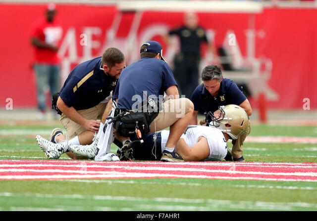 Houston, TX, USA. 27th Nov, 2015. Navy Midshipmen linebacker Tyler Goble (54) lays on the turf after sustaining - Stock Image