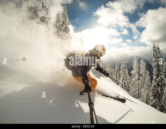 Austria, Salzburg, Zauchnsee, Person skiing in mountains - Stock Image