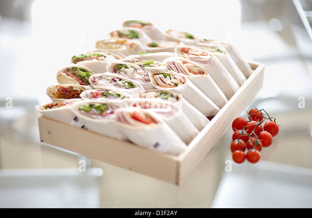 Large Box of sandwich wraps selection - Stock Image