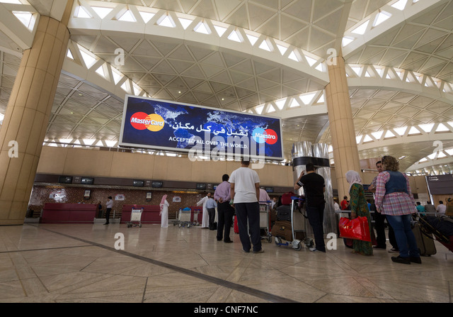 passengers checking in at Terminal 2, King Khalid International Airport, Riyadh, Saudi Arabia - Stock Image