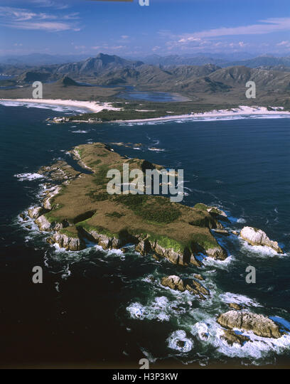 Mutton Bird Island with Chatfield Piont and Stephens Bay beyond. - Stock Image