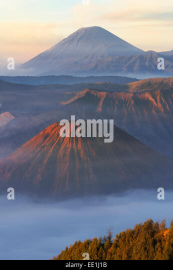 Sunrise over the smoking Gunung Bromo volcano, Bromo-Tengger-Semeru National Park, Java, Indonesia, Southeast Asia, - Stock Image