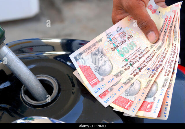 Hand showing currency of one thousand rupees MR#364 - Stock Image