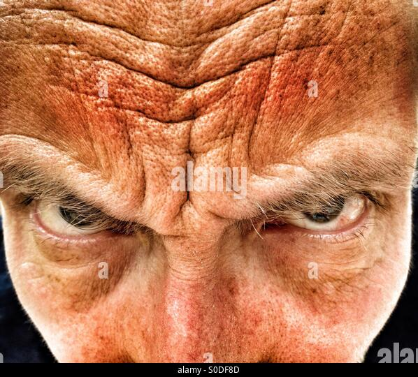 Middle aged man frowning - Stock Image