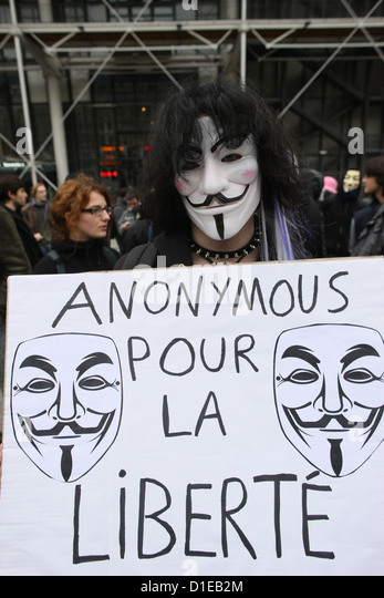 Protestor wearing Guy Fawkes mask of the Anonymous movement and based on a character in the film V for Vendetta, - Stock Image
