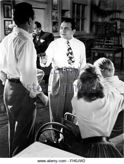 KEY LARGO (1948) - Edward James Robinson (center).  Courtesy Granamour Weems Collection. Editorial use only. Licensee - Stock Image