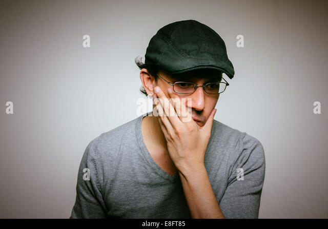 Man with hand on chin, portrait - Stock Image