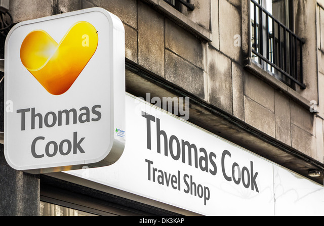 Shop window and signboard with logo of Thomas Cook travel shop / agency - Stock-Bilder