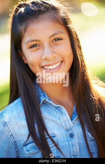 Portrait Of Hispanic Girl In Countryside - Stock Image